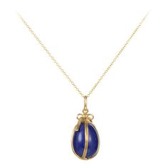 Tiffany & Co. Schlumberger Lapis Yellow Gold Egg Pendant Necklace | From a unique collection of vintage necklace enhancers at https://www.1stdibs.com/jewelry/necklaces/necklace-enhancers/