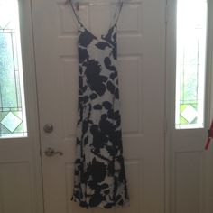 MAKE OFFER ! Rebecca Minkoff maxi dress This dress has a beautiful cut. True size 6. Has adjustable straps. I bought this for myself and live the dress just not sure I love the pattern. It is black on white background. Paint spatter. Rebecca Minkoff Dresses Maxi