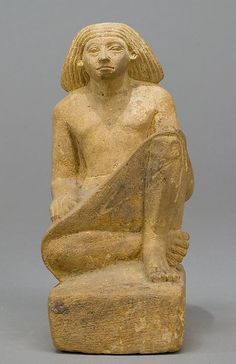 Statue of an asymmetrically seated man from the Middle Kingdom to Early New Kingdom Period, between the 12th to 18th Dynasty, ca. 1981-1550 BC.