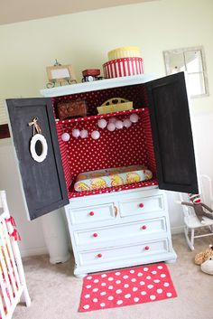 Changing table made from repurposed Armoire. Complete with lights.