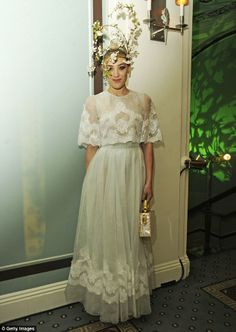 White fairy: Mia Moretti wears an ivory outfit, with a pretty extravagant headpiece
