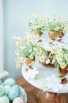 Fill wooden egg cups with fresh chamomile, and pen little tags with guest names.