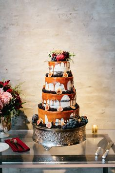 drizzle wedding cake topped with figs and flowers