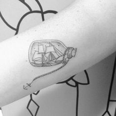 tiny ship in a bottle tattoo with anchor