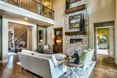 Your family will adore spending time in your #new #Austin #home with a spacious #livingroom featuring an elegant #stone #fireplace and charming #hardwood #floors. #furniture #decor #interior #design #ideas