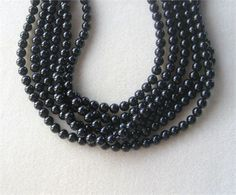 Black Onyx, Round Beads, Gemstone Beads, Stone Beads, Ball Beads, Jewelry Making Beads, Black Beads, Necklace Design, 15 Strand 8mm   1 - 15 strand of grade A, black onyx round beads. They are beautiful beads that are highly polished and measure 8mm in size with 50 beads on the strand. These beads go great with purple jade, white snow quartz and silver findings. Beautiful grade A black onyx round beads. A must have in any bead stash. Great for designing necklaces, bracelets or earrings.Must…