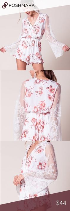 Floral lace bell sleeve romper 💜💕💐 A textured chiffon romper with a surplice bodice, elastic drawstring waist, and dramatic sheer white mesh sleeves with lace accents. Crochet tabbed accents at chest. Slanted ruffle leg openings. Unlined. Nasty Gal Dresses Mini