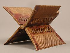 Folding Comb;  Date: ca. 1500;  Culture: Tyrolean;  Medium: Boxwood;  Dimensions: Overall (opened): 2 3/4 x 3 5/16 x 4 1/8 in. (7 x 8.4 x 10.5 cm) Overall (collapsed): 4 3/16 x 3 5/16 x 5/16 in. (10.6 x 8.4 x 0.8 cm);  Classification: Woodwork-Miscellany;  Accession Number: 1985.200