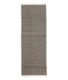 White/charcoal gray. Rectangular rug in cotton fabric with a jacquard-weave pattern.