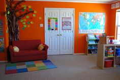 school room - love the map, alphabet cards, sofa.- i recognize that rug. Daycare Rooms, Home Daycare, Daycare Ideas, School Ideas, Reading Tree, Reading Nook, Study Space, Classroom Setup, Toddler Classroom