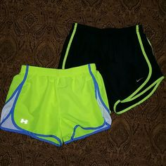 Women's Nike & Under Armour SM Running Shorts Nike Black Tempo Shirts with neon yellow trim. Under Armour bright yellow with blue & white trim. Both have built in liners and in great shape.?? Nike Shorts