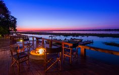 Whats more mesmerizing? The open fire or the scenery ? Outdoor Tables, Outdoor Decor, Open Fires, Sunsets, Beaches, Scenery, Outdoor Furniture, Luxury, Home Decor