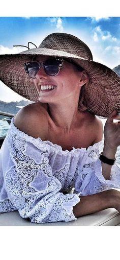 Olivia Palermo: Dress – Temptation Positano  sunglasses – Fendi