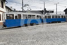 The retro tram and people in the old depot  on Wawrzynca street in jewish part of Krakow. Poland.