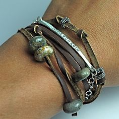 a cool way to display pandora beads.. on a leather bracelet.