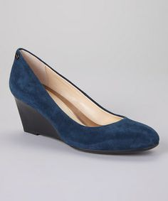 Elevate the allure of any ensemble with this stylish pair. Its luscious suede finish offers luxurious appeal, while the manageable wedge heel lengthens the leg for a sleek look.
