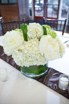 Centerpiece Featuring White Hydrangeas, White Peonies and Bear Grass; love these flowers so pretty as a center piece