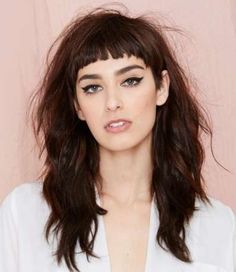 Short cropped bangs with long messy hair. Love it.