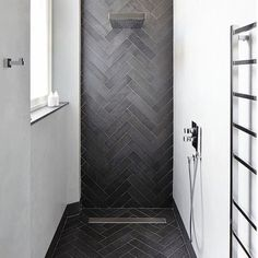 Herringbone Shower #herringbone #shower #bathroom #bathroominspo #bathroomtiles #towelrack ...