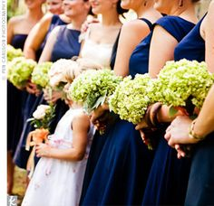Navy bridesmaids dresses with green hydrangeas.