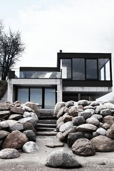 Modern architecture with a rough natural look appears to rise out of the ground. Well set and composed, great materials choices!