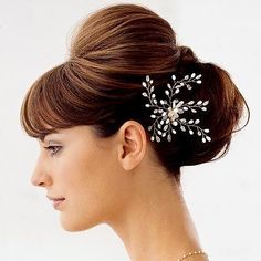 With straight bangs and low bun for wedding
