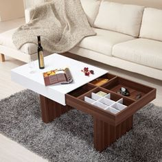 @Overstock - Modern and elegant, this Novia coffee table features contrasting finishes of white and walnut to create a one of a kind experience. A side storage compartment adds functionality to this beautiful coffee table.http://www.overstock.com/Home-Garden/Novia-2-Tone-Wood-Coffee-Table/5328003/product.html?CID=214117 $127.49