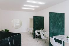 #HTE Real Estate Agency in Portugal by Fala Atelier Features Marble Partitions. This clever little fitout by