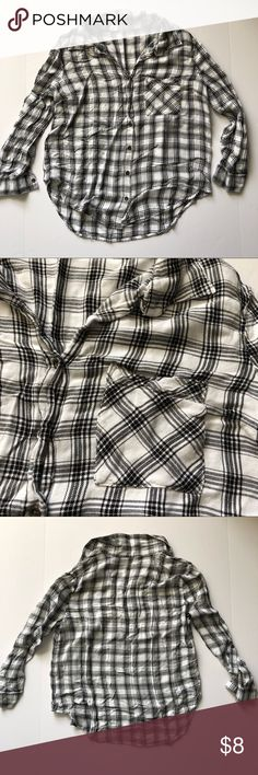 Woman's plaid white and black Button Down Beautiful black and white plaid long sleeve button down. Tag is cut out but the brand is Faded Glory and it fits like a size Small. In excellent condition and comes from smoke free home. Faded Glory Tops Button Down Shirts