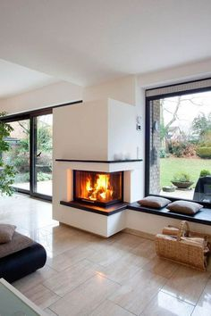 Der zweiseitige Heizkamin ist in der gartenseitigen Fensterfront integriert. Rec… The two-sided fireplace is integrated in the garden-side window front. Right, the windowsill has been expanded to a seat. Home Fireplace, Modern Fireplace, Living Room With Fireplace, Fireplace Design, Fireplaces, Open Plan Kitchen Living Room, Open Plan Living, Double Sided Fireplace, House Extension Design