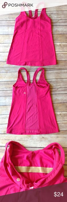 Lululemon pink tank top size 8 with built in bra Pre-own ended women's Lululemon pink workout yoga tank top with built in bra size 8. Excellent used condition. No rips holes or stains.  I ship fast! Thanks for looking! Check out my other items! lululemon athletica Tops Tank Tops