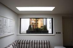 www.iqglassuk.com    Minimal Windows sliding doors used as small sliding window to basement room.
