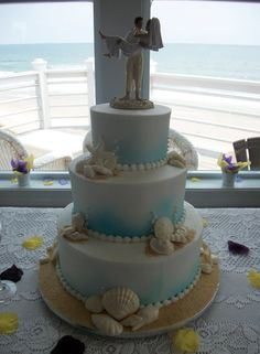 Wedding cake beach theme by www.americandreamcakes.com #beach #seashells #blue
