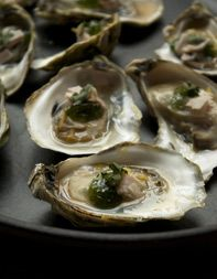 Bourbon Roasted Oyster with Country Ham Recipe | Tasting Table