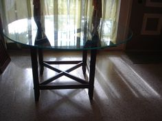 round glass top dining table wood base