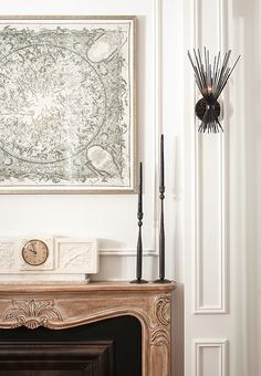 Eclectic,  fireplace, sculptural candlesticks, modern-artsy sconces. Decorating Ideas to Steal from Club Monaco