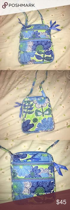 Vera Bradley cross body purse Beautiful green and blue pattern with a ton of pockets and compartments. You can wear it across your body or over the shoulder. Vera Bradley Bags Crossbody Bags