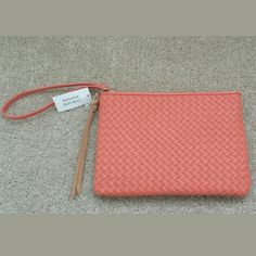Banana Republic coral woven clutch MOVING SALE!!! PRICED TO SELL. NO OFFERS PLEASE.  NWT Banana Republic coral woven clutch w/wrist strap Dimensions: 9.5L x 6.75H x .75W Banana Republic Bags Clutches & Wristlets