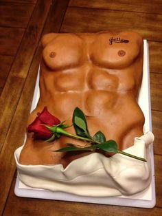 Sexy man with birthday cake