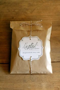 asimple kraft gift bag, sweetly tied up with striped bakers twine and a biz name tag