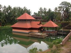 The Temple lake or tank in which the Sanctum is situated is a large structure measuring 302 feet square (about 2 acres). Kerala Architecture, Vernacular Architecture, Art Nouveau, Art Deco, South India, Place Of Worship, Karnataka, Acre, Gazebo