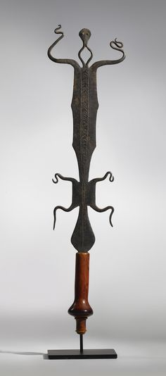 Africa   Prestige Knife.  Lobala or Nzombo culture ~ Democratic Republic of the Congo and Angola   The handle made of African Elephant (Loxodonta africana) ivory, the eyes inlaid with copper.