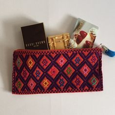 """Beautiful Hand Made Artisan Bag *Hand made beautiful artisan bag from Chiapas, Mexico.                                                             *Every bag is unique in color and design.                    *Perfect for you to keep it inside your bag, great for pencils and colors, money, make up or any necessities keeper.                                             *Great to give as a gift.     Not UO                                            *Avrg size 4"""" x 8"""".  *Price is FIRM! Urban…"""