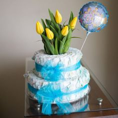 Las mejores flores en www.kukyflor.com #kukyflor #florerialima Torta de Pañales con Tulipanes #kukyflor