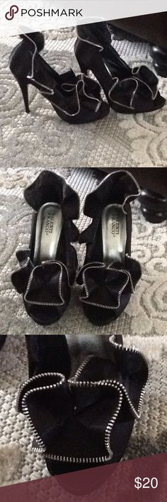 Fashion black heels These are a show piece.  They are made for showing off. Not the most comfortable shoe you will ever wear but they will get a lot of attention. The brand is Valenti Franco. The fabric is very stiff. Like I said made for fashion vs comfort. I paid $70 for them new. Wore them once. I can no longer wear heels. So they have been  hanging out it my closet. Yes it is trimmed in a sliver zipper. Valenti Franco  Shoes Heels
