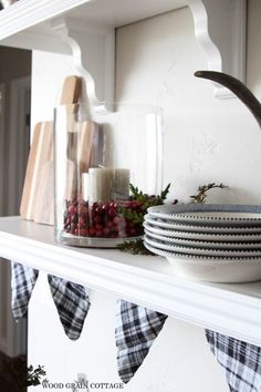 Christmas Home Tour - The Wood Grain Cottage   Greenery, berries and candle in large glass container.