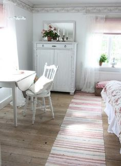 Sunny bedroom-look at the bureau and the rug! And I have a table just like that!  Ahhhhh....