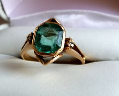 Diamond and Colombian Emerald Ring.  I am seriously in love with this ring.