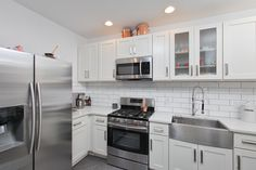 Modern kitchen remodel in Queen Village, Philadelphia to include up-to-date appliances and materials.