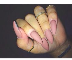 Minus that unpainted spot on her nails I love this color and shape Next nail trip